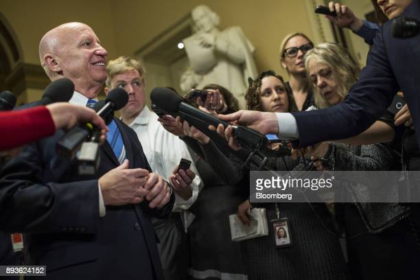 Representative Kevin Brady a Republican from Texas and chairman of the House Ways and Means Committee left smiles while speaking to members of the...