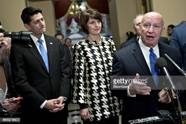 Representative Kevin Brady a Republican from Texas and chairman of the House Ways and Means Committee right speaks as US House Speaker Paul Ryan a...