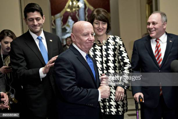 Representative Kevin Brady a Republican from Texas and chairman of the House Ways and Means Committee center arrives to speak at a news conference...
