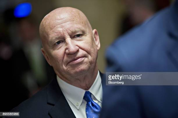 Representative Kevin Brady a Republican from Texas and chairman of the House Ways and Means Committee listens during a news conference after voting...