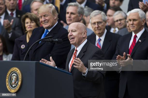 Representative Kevin Brady a Republican from Texas and chairman of the House Ways and Means Committee center speaks during a tax bill passage event...
