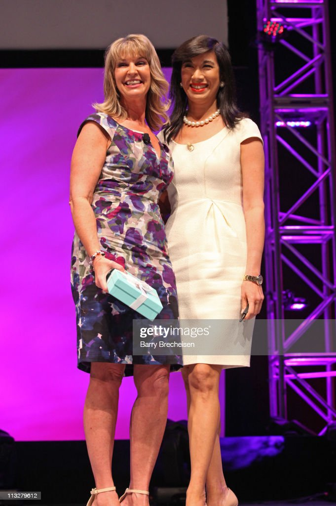 AVON representative Kim Calder (L) and AVON Chairman and CEO Andrea Jung attend the AVON Believe World Tour on April 29, 2011 in Chicago, Illinois.