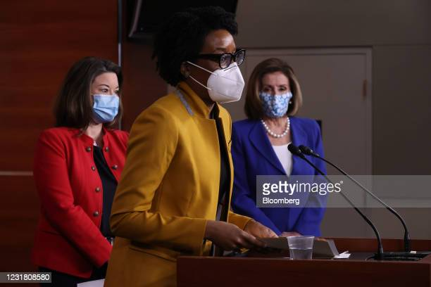 Representative Lauren Underwood, a Democrat from Illinois, center, wears a protective mask while speaking during a news conference at the U.S....