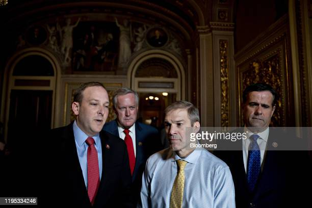 Representative Lee Zeldin, a Republican from New York, left, speaks to members of the media as Representative John Ratcliffe, a Republican from...