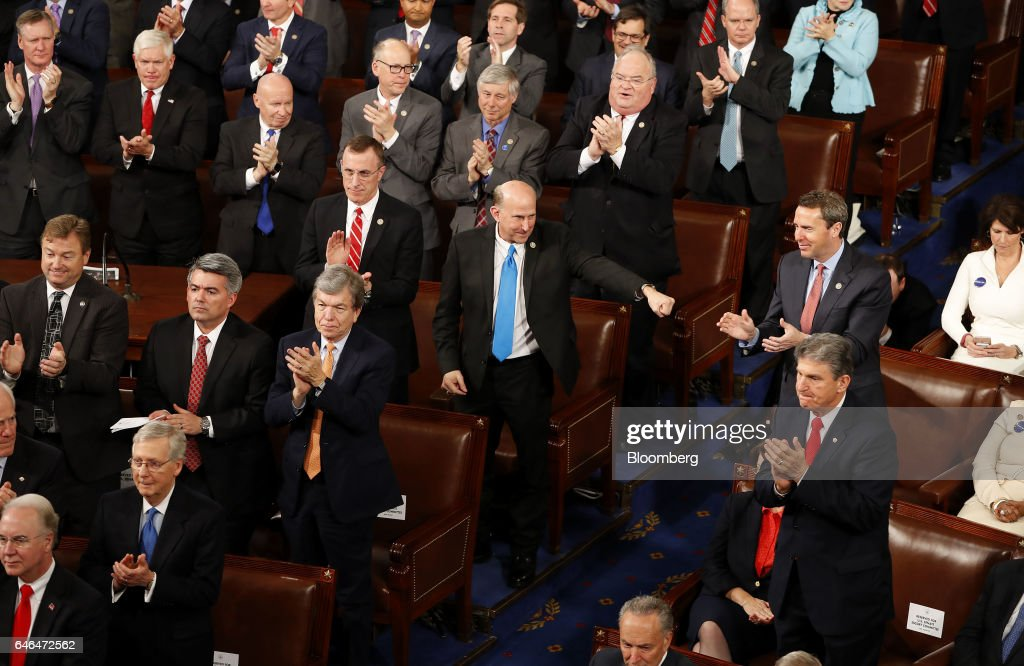 Representative Louie Gohmert, a Republican from Texas, center, gestures as U.S. President Donald Trump, not pictured, speaks during a joint session of Congress in Washington, D.C., U.S., on Tuesday, Feb. 28, 2017. Trump will press Congress to carry out his priorities for replacing Obamacare, jump-starting the economy and bolstering the nation's defenses in an address eagerly awaited by lawmakers, investors and the public who want greater clarity on his policy agenda. Photographer: Aaron P. Bernstein/Bloomberg via Getty Images