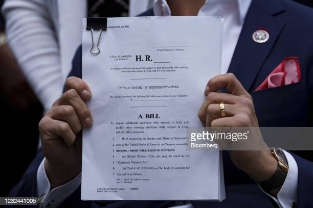 Representative Madison Cawthorn, a Republican from North Carolina, holds up a copy of legislation during a news conference outside the U.S. Capitol...