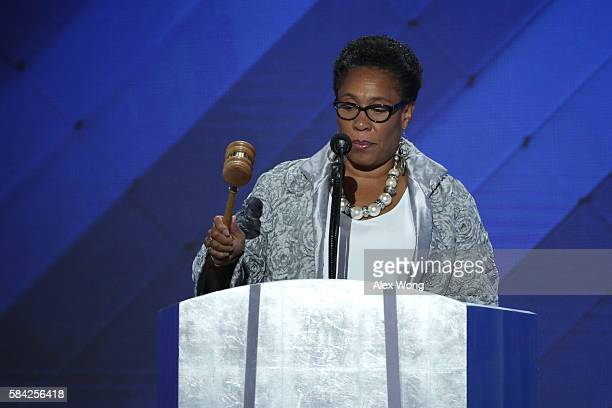 S Representative Marcia Fudge bangs the gavel calling to order the fourth day of the Democratic National Convention at the Wells Fargo Center July 28...