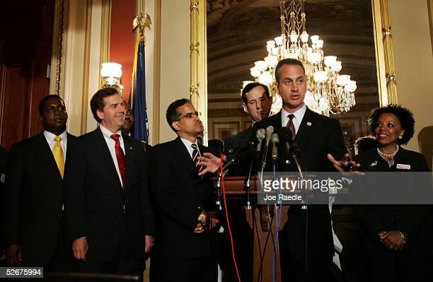S Representative Mario DiazBalart speaks as Bob McFadden Sen Jim DeMint David J Byrd Sen Rick Santorum and Sylvia Thompson an attorney from Brooklyn...