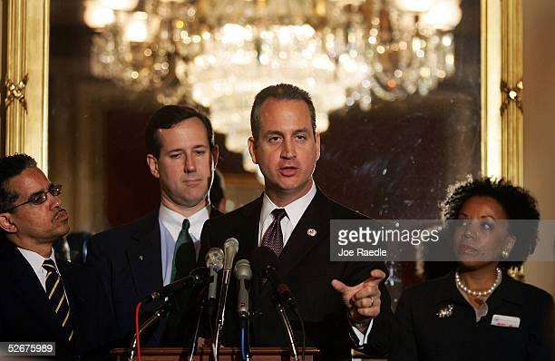 S Representative Mario DiazBalart speaks as David J Byrd Sen Rick Santorum and Sylvia Thompson an attorney from Brooklyn New York listen during a...