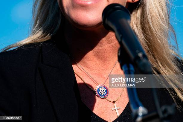 Representative Marjorie Taylor Greene, Republican of Georgia, wears a Congressional medallion and a necklace with a cross during a press conference...