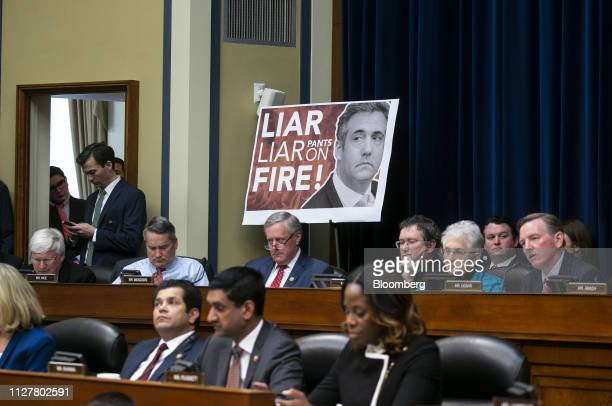 Representative Mark Meadows, a Republican from North Carolina, center, listens during a hearing with Michael Cohen, former personal lawyer to U.S....