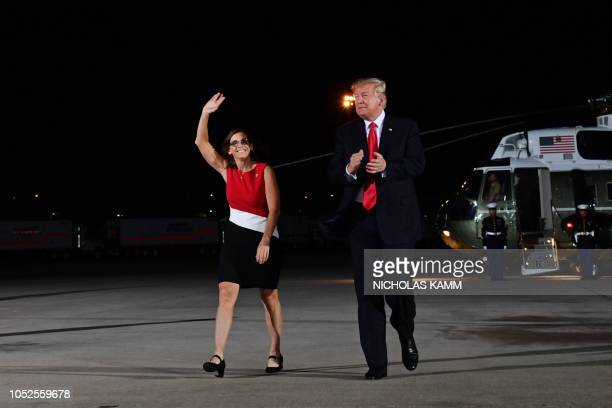 Representative Martha McSally and US President Donald Trump arrive at a Make America Great rally in Mesa Arizona on October 19 2018 US President...