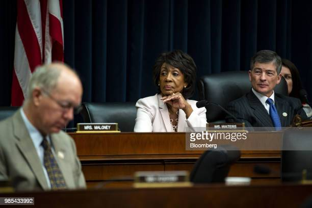 Representative Maxine Waters a Democrat from California and ranking member of the House Financial Services Committee center and Representative Jeb...