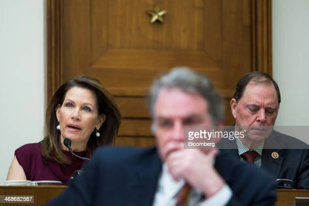 Representative Michele Bachmann, a Republican of Minnesota, left, questions Federal Reserve Chairman Janet Yellen, unseen, during Yellen's...
