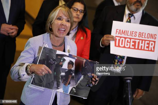 Representative Michelle Lujan Grisham a Democrat from New Mexico demonstrates during a House Republican conference meeting on immigration legislation...