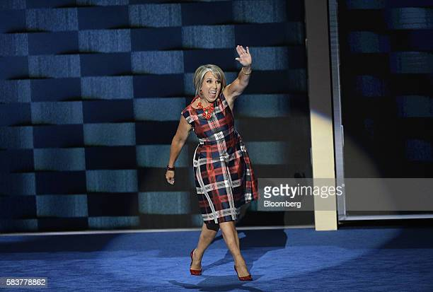 Representative Michelle Lujan Grisham a Democrat from New Mexico waves while arriving onstage during the Democratic National Convention in...