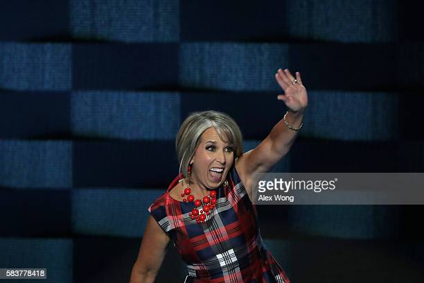 S Representative Michelle Lujan Grisham waves to the crowd as she walks on stage to deliver remarks on the third day of the Democratic National...