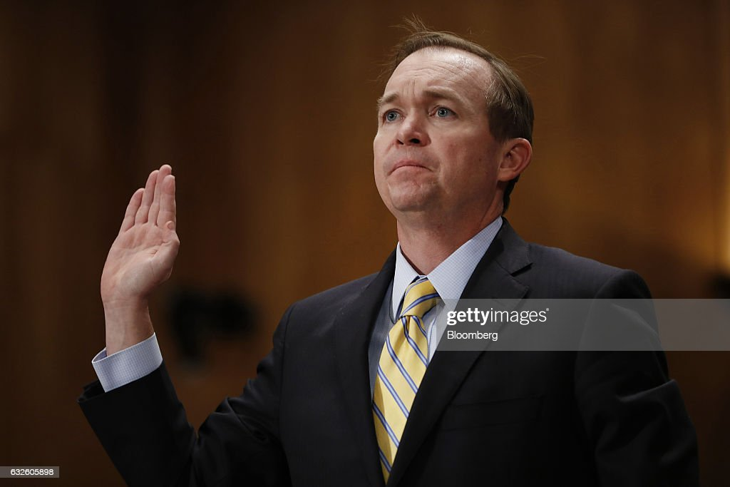 Representative Mick Mulvaney, a Republican from South Carolina and Office of Management and Budget director nominee for U.S. President Donald Trump, is sworn in during a Senate Governmental Affairs Committee confirmation hearing in Washington, D.C., U.S., on Tuesday, Jan. 24, 2017. Mulvaney said Tuesday the nearly $20 trillion national debt needs to be 'addressed sooner rather than later' and that he would push Trump to break his campaign promises and cut Social Security and Medicare. Photographer: Aaron P. Bernstein/Bloomberg via Getty Images