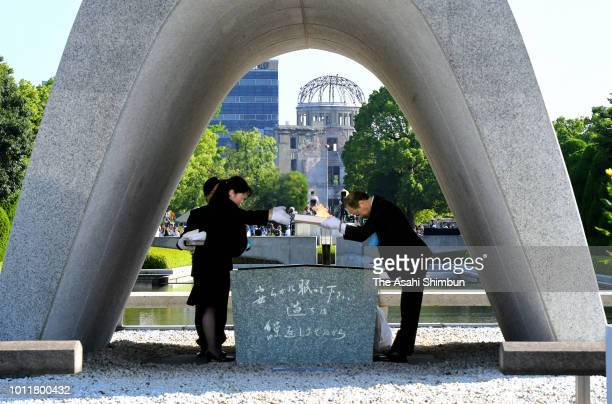 A representative of bereaved family members hands in the victim's name books in which 5393 people's names had been added to Hiroshima City Mayor...