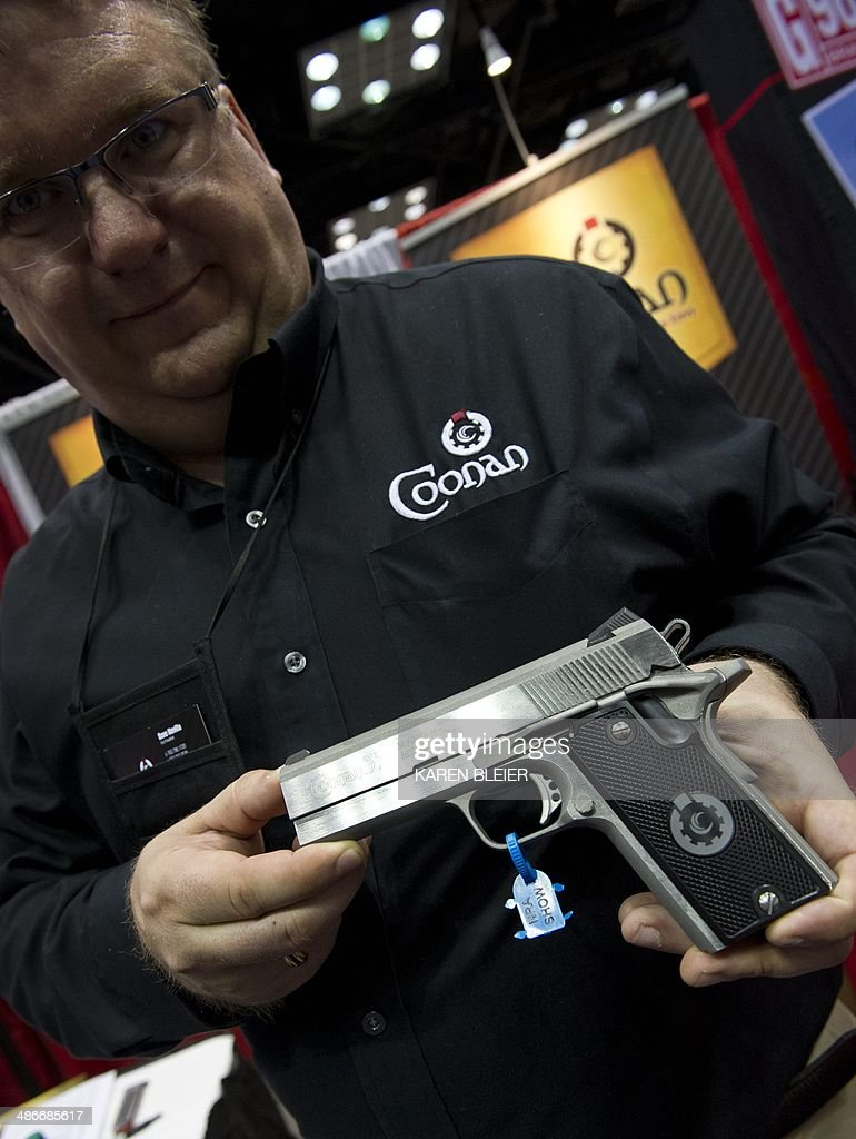 A representative of Coonan firearms displays a  357 Magnum