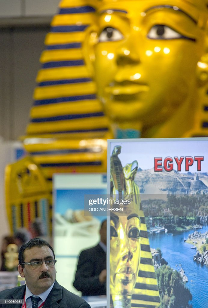 A representative of Egypt's travel industry waits on the booth at the ITB international tourism fair at the fairgrounds in Berlin on March 9, 2012. The ITB travel trade show, with 10,644 exhibitors from 187 countries, is due to run until March 11.