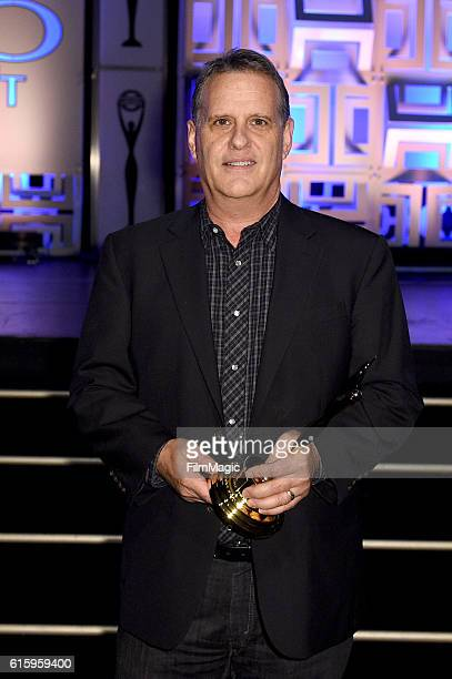 A representative of FX Networks poses with the Television Teaser Grand award for 'Man Seeking Woman' during the CLIO Key Art Awards 2016 at Dolby...