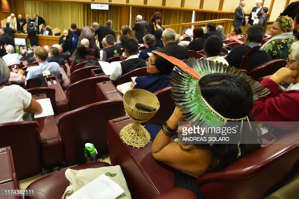 A representative of one of the Amazon Rainforest's ethnic groups attends the morning session on the second day of the Special Assembly of the Synod...