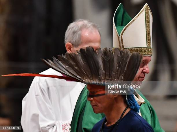 A representative of one of the Amazon Rainforest's ethnic groups takes part in a Pope Francis' mass on October 6 2019 at St Peter's Basilica in the...