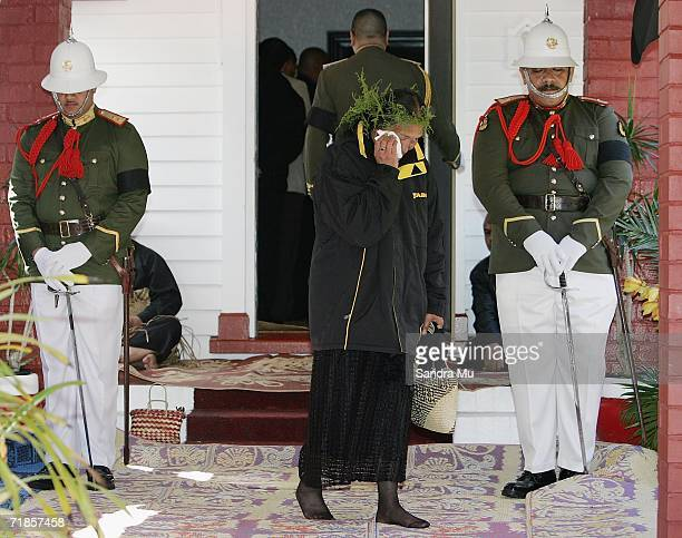 Representative of Tainui sheds a tear after paying her respects to the Late King of Tonga, Taufa'ahau Tupou IV in Epson, September 12, 2006 in...