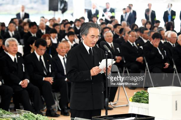 A representative of the Minamata Disease victims and family members attend a memorial on the 62nd anniversary of the mercurypoisoning disease on May...