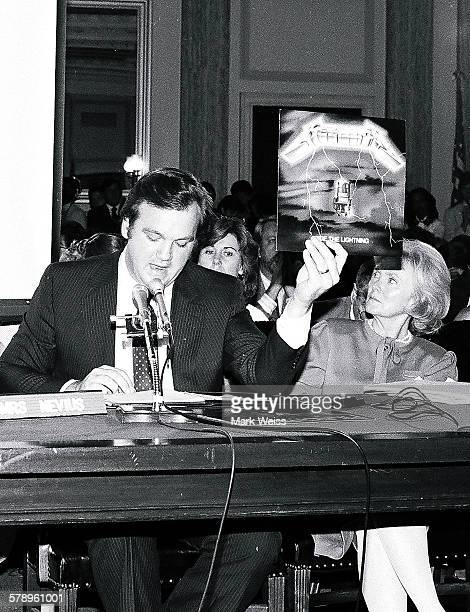 A representative of the PMRC holds up a Metallica album cover at a senate hearing at Capitol Hill Washington DC United States 19th September 1985...