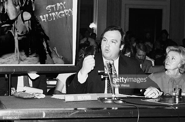 A representative of the PMRC talks in front of a Twisted Sister album cover at a senate hearing at Capitol Hill Washington DC United States 19th...