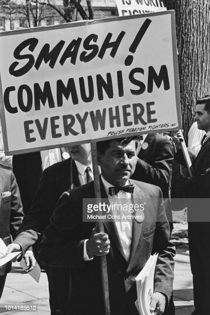 A representative of the Polish Freedom Fighters Inc holds a placard reading 'Smash Communism Everywhere' at a proVietnam War rally in Washington DC...
