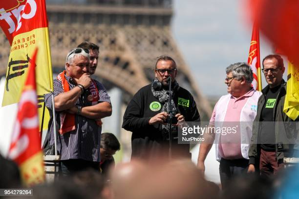 Representative of the SUD Rail union Bruno Poncet with General Secretary of French workers' union CGT rail federation Laurent Brun and French CFDT...