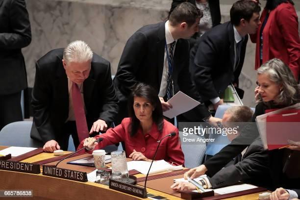 Representative of Ukraine to the United Nations Volodymyr Yelchenko speaks to US Ambassador to the United Nations Nikki Haley during a meeting of the...