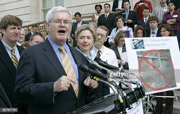 Representative Patrick Kennedy and U.S. Senator Hillary Rodham Clinton listen to former House Speaker Newt Gingrich speak during a media conference...