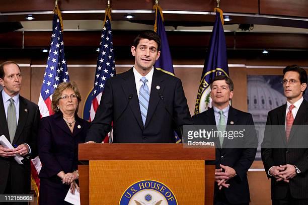 Representative Paul Ryan a Republican from Wisconsin center speaks while Representatives Dave Camp a Republican from Michigan left Diane Black a...