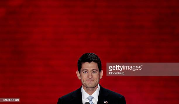 Representative Paul Ryan Republican vice presidential candidate smiles before speaking at the Republican National Convention in Tampa Florida US on...