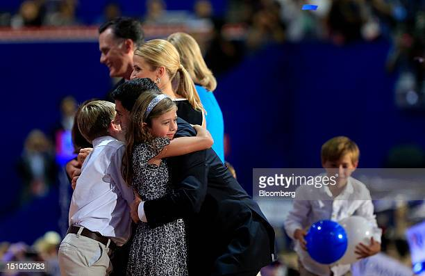Representative Paul Ryan Republican vice presidential candidate hugs his daughter Liza Ryan at the Republican National Convention in Tampa Florida US...