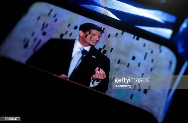 Representative Paul Ryan, Republican vice presidential candidate, is seen on a screen while speaking in this photo taken with a tilt shift lens at...