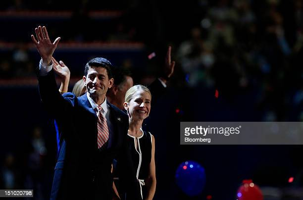 Representative Paul Ryan Republican vice presidential candidate left waves while on stage with wife Janna Ryan at the Republican National Convention...