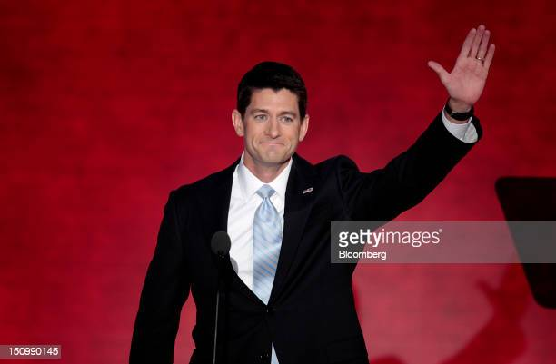 Representative Paul Ryan Republican vice presidential candidate waves before speaking at the Republican National Convention in Tampa Florida US on...