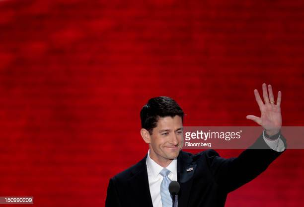 Representative Paul Ryan, Republican vice presidential candidate, waves before speaking at the Republican National Convention in Tampa, Florida,...