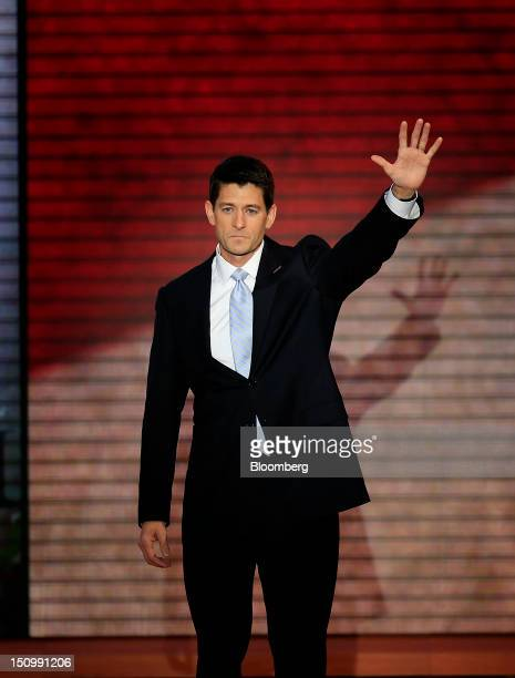 Representative Paul Ryan, Republican vice presidential candidate, waves after speaking at the Republican National Convention in Tampa, Florida, U.S.,...