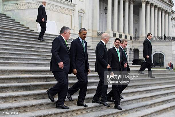 Representative Peter King President Barack Obama Speaker of the House Paul Ryan and Irish Taoisech Enda Kenny walk down the steps of the US Capitol...