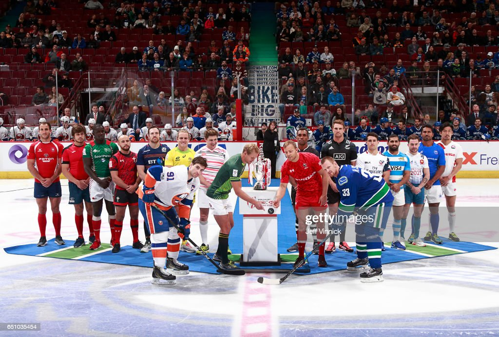 Representative players from the World Rugby Sevens Series drop the puck for Daniel Sedin #22 of the Vancouver Canucks and John Tavares #91 of the New York Islanders before the NHL game at Rogers Arena March 9, 2017 in Vancouver, British Columbia, Canada.