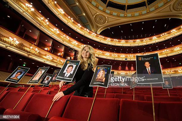 Representative poses with images of BAFTA nominees during a photo call four days ahead of the awards ceremony at the Royal Opera House in central...