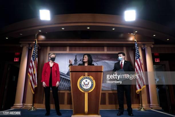 Representative Pramila Jayapal, a Democrat from Washington, center, speaks while Senator Elizabeth Warren, a Democrat from Massachusetts, left, and...