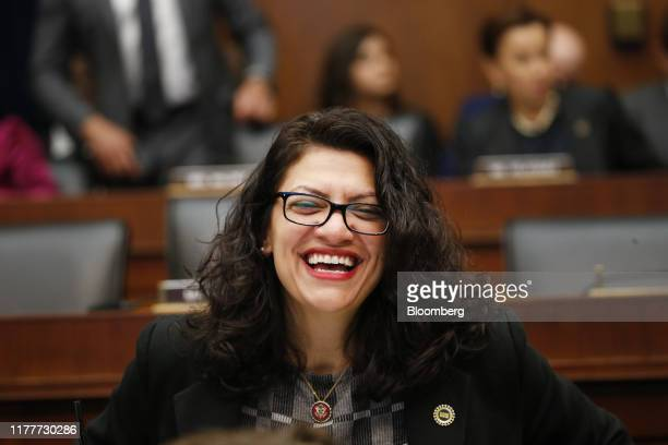Representative Rashida Tlaib, a Democrat from Michigan, smiles before the start of a House Financial Services Committee hearing with Mark Zuckerberg,...
