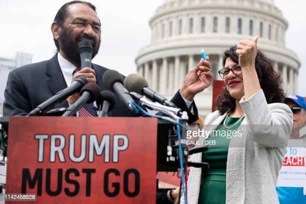 Representative Rashida Tlaib , Democrat of Michigan, and US Representative Al Green, Democrat of Texas, hold a computer flash drive during a press...